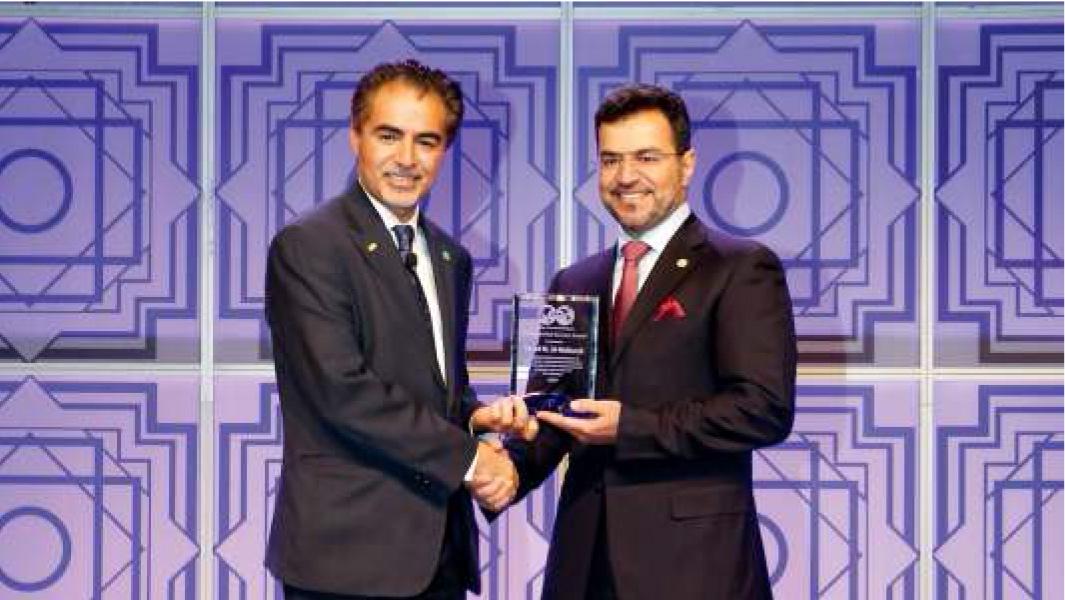 Saeed M. Al-Mubarak, right, accepts the Society of Petroleum Engineers Distinguished Service Award from organization president Sami A. Alnuaim.